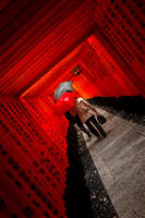 Red & Black Umbrella at the Fushimi Inari Shrine in Kyoto by Chr